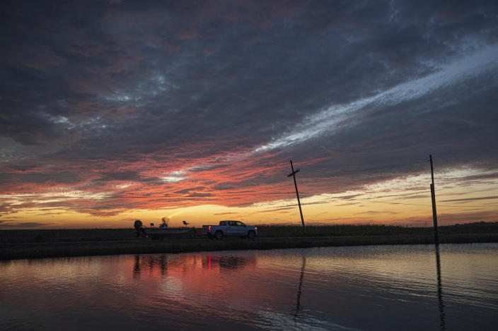 A sport fisherman leaves Pointe Aux Chenes in Terrebonne Parish ahead of Hurricane Delta on Wednesday, Oct. 7, 2020. Delta could make landfall, possibly as a Category 3 storm, sometime Friday south of Morgan City, La. (David Grunfeld/The Times-Picayune/The New Orleans Advocate via AP)