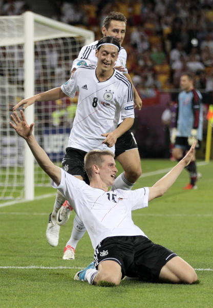 Germany's Lars Bender, bottom, celebrates after scoring his side's second goal during the Euro 2012 soccer championship Group B match between Denmark and Germany in Lviv, Ukraine, Sunday, June 17, 2012. (AP Photo/Ivan Sekretarev)