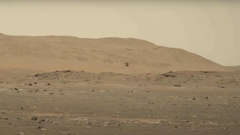 The Ingenuity helicopter flying around Mars
