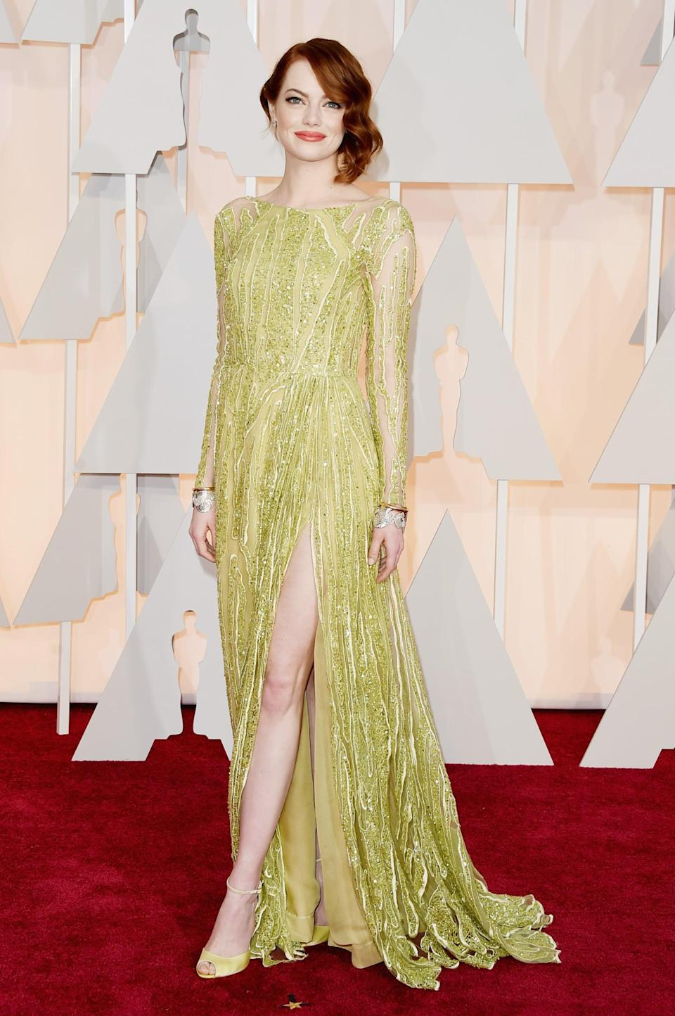 <p>In an unexpected move, Emma opted for a chartreuse custom Elie Saab gown in 2015.</p>