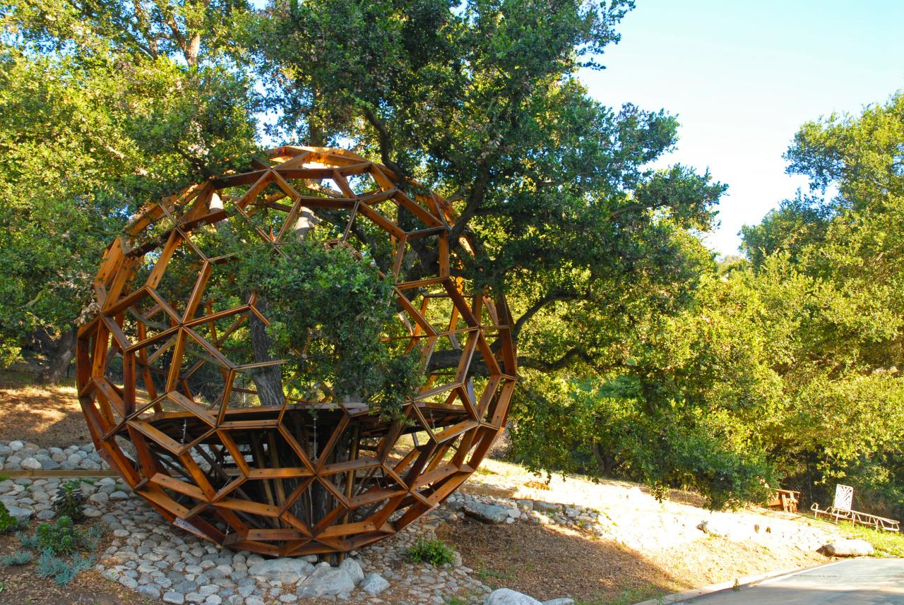 """<p>Dustin Feider wanted to design an <a href=""""http://o2treehouse.com"""">eco-friendly treehouse</a> that could sit among branches and against bark without causing any harm to the tree itself. Inspired by the architecture of Buckminster Fuller, Feider's 13-foot wide geodesic domes hang on thick cables (with no nails or bolts needed, it won't hurt the tree), using a modular design that can accommodate just about any tree or trunk. And the neon-bright globes are made entirely out of recycled materials like reclaimed steel and upcycled copper and bamboo.</p>"""
