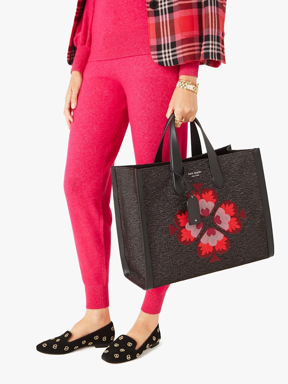 <p>The <span>Manhattan Spade Motif Jacquard Large Tote</span> ($398) is stunning and useful - you can fit your laptop in it and plenty more.</p>