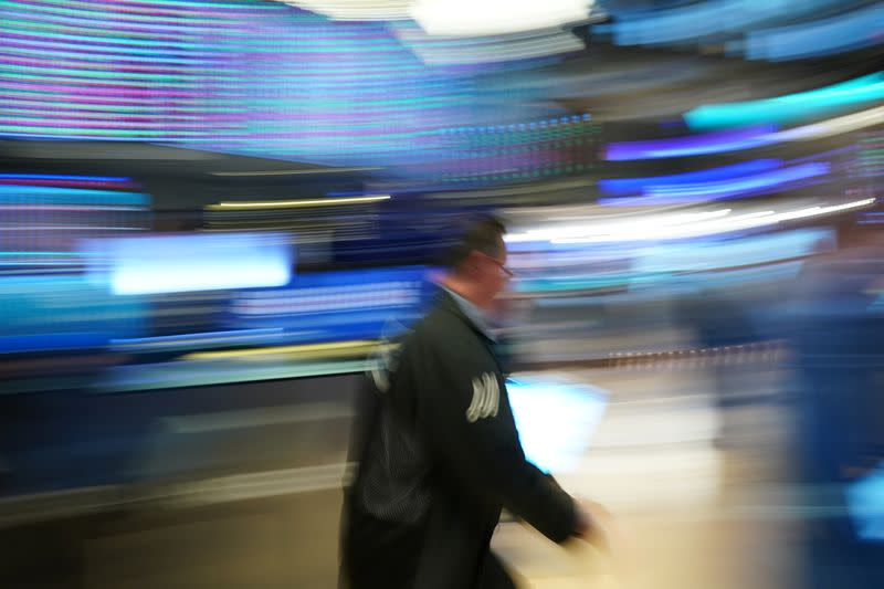 Stocks wobble in early trading, but head for weekly gains