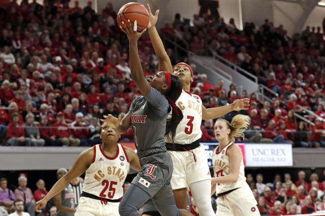 Louisville guard Dana Evans (1) drives to the basket while North Carolina State guard Kai Crutchfield (3) defends during the first half of an NCAA college basketball game in Raleigh, N.C., Thursday, Feb. 13, 2020. (AP Photo/Gerry Broome)