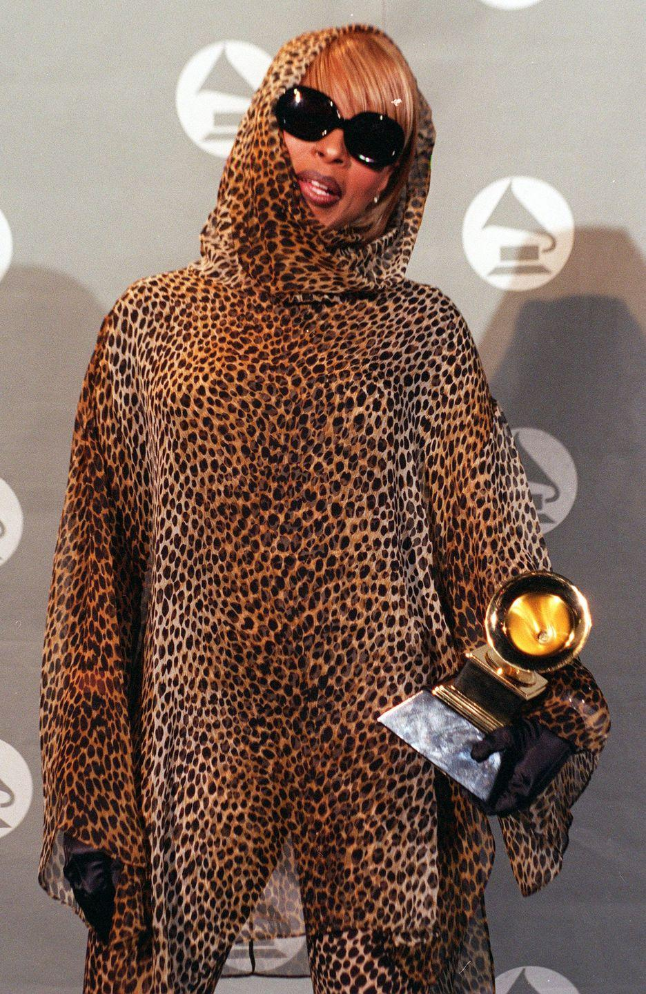 <p>Mary J. Blige went ALL out with the leopard print at the Grammys and even picked up an award for Best Rap Performance by a Duo or Group. Her hood and oversize shades definitely complete the 'fit. </p>