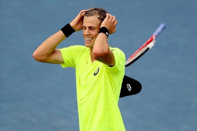 MONTREAL, QC - AUGUST 08: Vasek Pospisil of Canada celebrates match point against Tomas Berdych of Czech Republic during the Rogers Cup at Uniprix Stadium on August 8, 2013 in Montreal, Quebec, Canada. (Photo by Matthew Stockman/Getty Images)