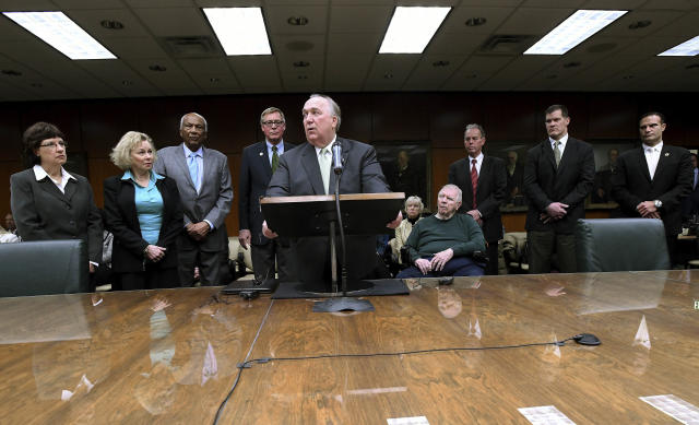FILE - In this Jan. 31, 2018, file photo, former Gov. John Engler speaks after Michigan State's Board of Trustees met and voted to name him as their interim president in East Lansing, Mich. Michigan State University has reached a $500 million settlement with hundreds of women and girls who say they were sexually assaulted by sports doctor Larry Nassar in the worst sex-abuse case in sports history. The deal was announced Wednesday, May 16, 2018 by Michigan State and lawyers for the 332 victims. (Dale G.Young//Detroit News via AP)