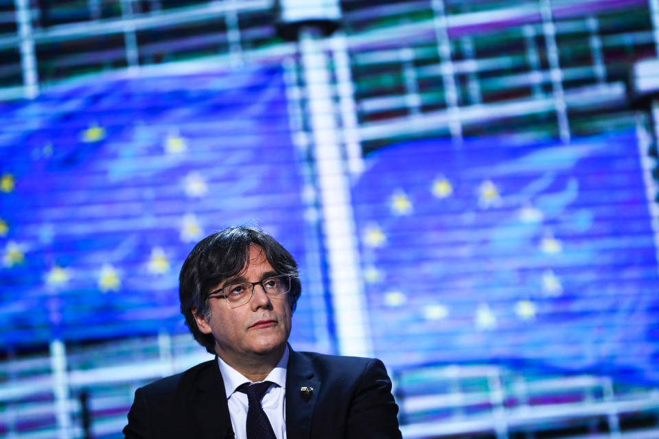FILE - In this Tuesday, March 9, 2021, file photo, member of European Parliament Carles Puigdemont prepares for an interview at the European Parliament in Brussels. The lawyer for Puigdemont says the former Catalan leader has been detained in Sardinia, Italy. Gonzalo Boye confirmed to the Associated Press that Puigdemont was detained on Thursday, Sept. 23. Boye wrote on Twitter that the former Catalan president, wanted by Spain for his role in an unauthorized referendum for independence, was being held under a European arrest warrant issued by Spain in 2019. (AP Photo/Francisco Seco, File)