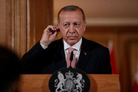 Turkey's President Recep Tayyip Erdogan, listens during a news conference with British Prime Minister Theresa May after their meeting at 10 Downing Street in London, Britain, May 15, 2018.  Matt Dunham/Pool via REUTERS