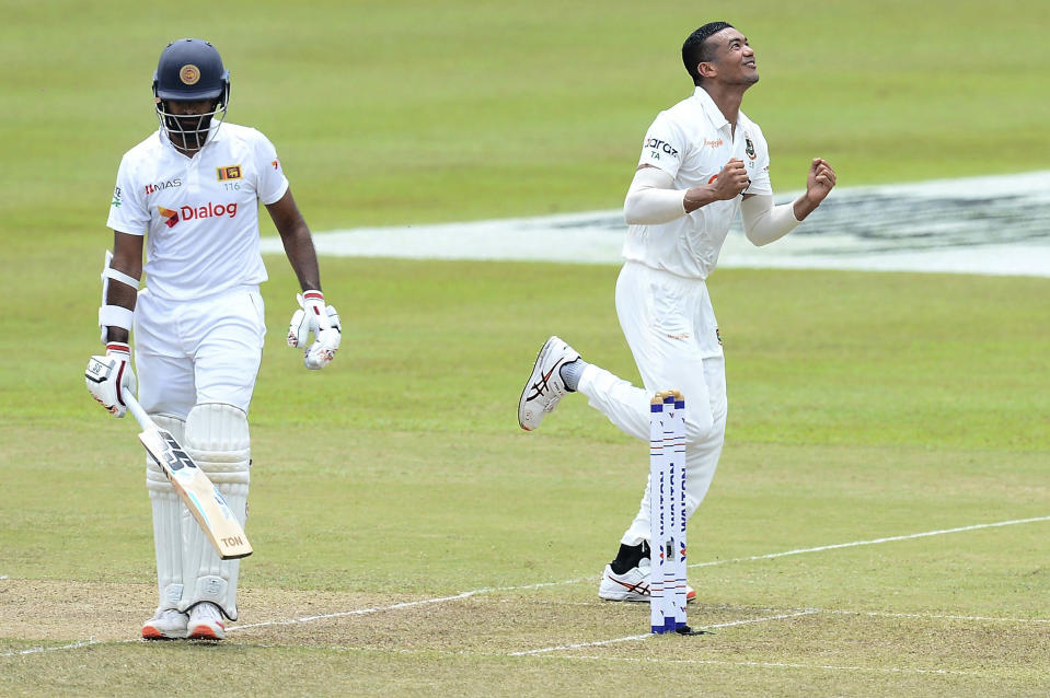 Bangladesh's Taskin Ahmed, right, celebrates the dismissal of Sri Lanka's Lahiru Thirimanne, left, during the second day of the second test cricket match between Sri Lanka and Bangladesh in Pallekele, Sri Lanka, Friday, April 30, 2021.( AP Photo/Sameera Peiris)