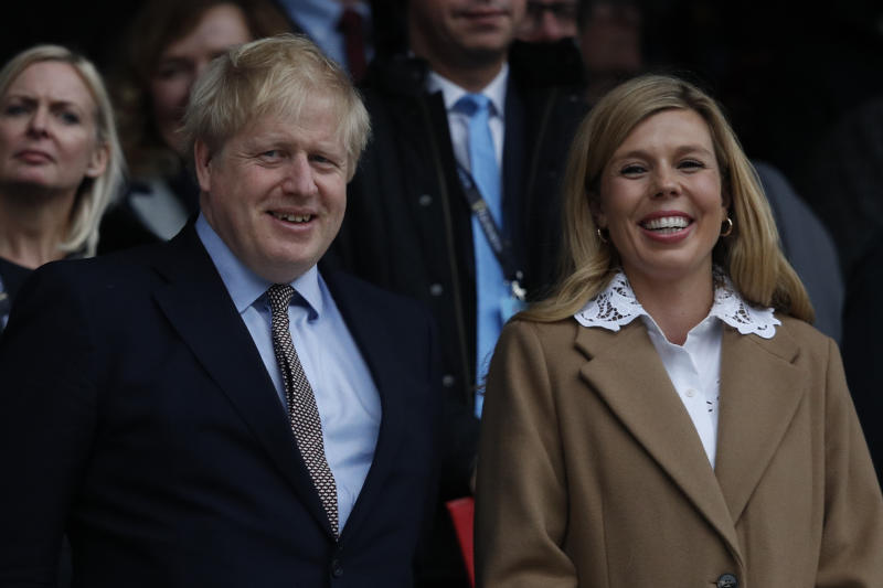 Boris Johnson and Carrie Symonds watched the Six Nations international rugby union match between England and Wales on 7 March. (Getty Images)