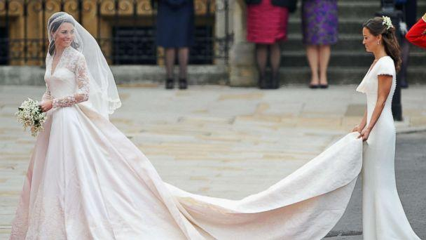 PHOTO: Catherine Middleton waves to the crowds as her sister and Maid of Honor Pippa Middleton holds her dress before walking in to the Abbey to attend the Royal Wedding of Prince William to Catherine Middleton at Westminster Abbey on April 29, 2011. (Pascal Le Segretain/Getty Images)