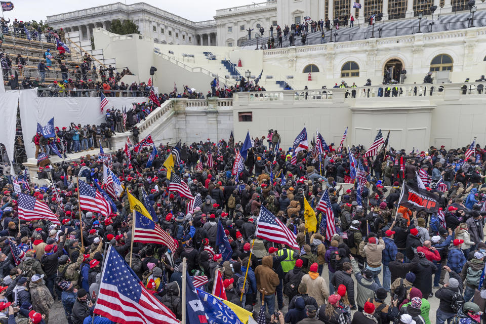 Pro-Trump protesters seen on and around Capitol building. Rioters broke windows and breached the Capitol building in an attempt to overthrow the results of the 2020 election. Police used batons and tear gas grenades to eventually disperse the crowd. Rioters used metal bars and tear gas as well against the police.