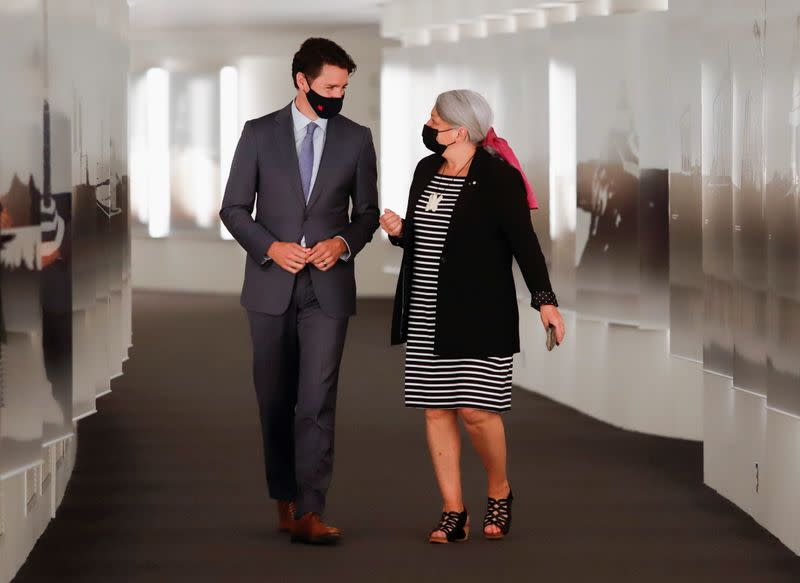 Canada's Prime Minister Justin Trudeau walks to a news conference with Mary Simon to announce her as the next Governor General of Canada in Gatineau