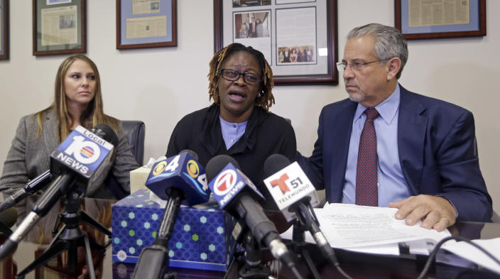 Gina Alexis, center, mother of 14-year-old Nakia Venant, who livestreamed her suicide on Facebook over the weekend, flanked by attorneys Stacie J. Schmerling, left, and Howard M. Talenfeld, right, weeps as she answers a question during a news conference, Wednesday, Jan. 25, 2017, shows a in Plantation, Fla. Nakia Venant's suicide is at least the third to be livestreamed nationally in the last month. (AP Photo/Alan Diaz)