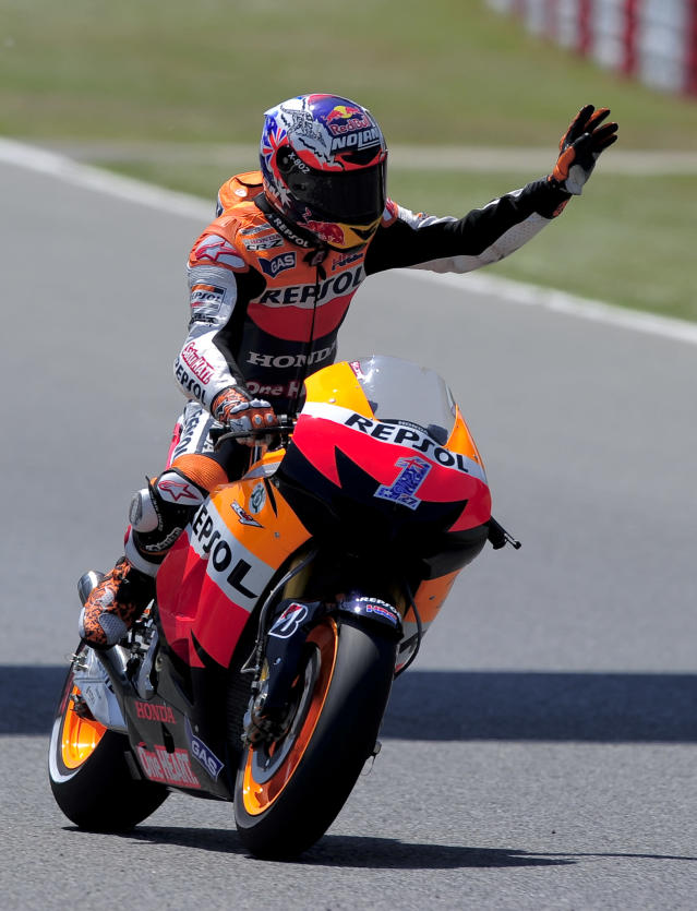 Repsol Honda Team's Australian Casey Stoner celebrates taking the pole position at the Catalunya racetrack in Montmelo, near Barcelona, on June 2, 2012, after the MotoGP qualifying session of the Catalunya Moto GP Grand Prix. AFP PHOTO / JOSEP LAGOJOSEP LAGO/AFP/GettyImages