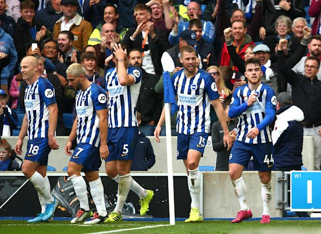 Aaron Connolly of Brighton and Hove Albion celebrates with teammates. (Photo by Charlie Crowhurst/Getty Images)