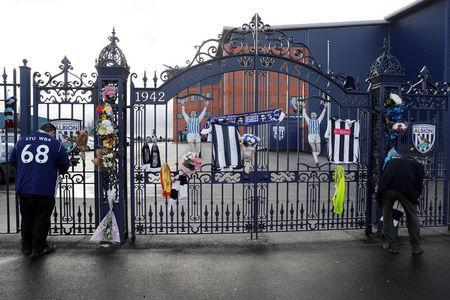 Fans leave tributes to Cyrille Regis at the Jeff Castle gates of West Bromwich Albion football club's The Hawthorns stadium in West Bromwich, Britain January 15, 2018. REUTERS/Darren Staples