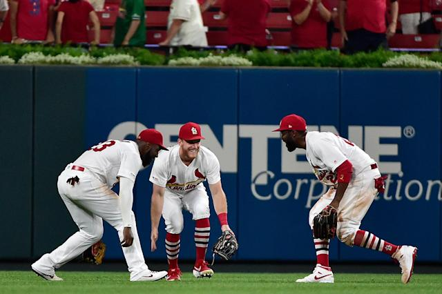 St. Louis Cardinals center fielder Harrison Bader (48) and left fielder Marcell Ozuna (23) and right fielder Dexter Fowler (25) celebrate after the Cardinals defeated the Washington Nationals at Busch Stadium. (Jeff Curry-USA TODAY Sports)