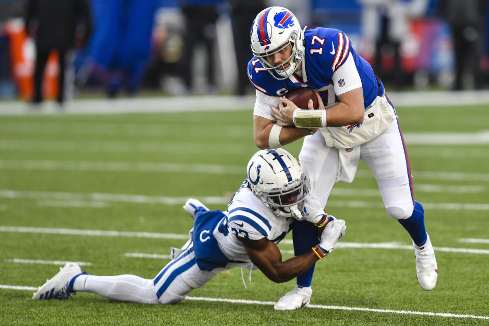 Indianapolis Colts' Kenny Moore II (23) tackles Buffalo Bills quarterback Josh Allen (17) during the second half of an NFL wild-card playoff football game Saturday, Jan. 9, 2021, in Orchard Park, N.Y. (AP Photo/Adrian Kraus)