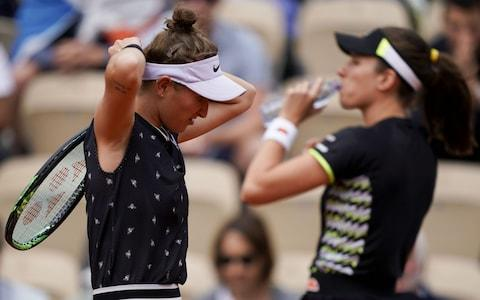 Czech Republic's Marketa Vondrousova (L) and Britain's Johanna Konta warm up at the start of their women's singles semi-final match on day 13 of The Roland Garros 2019 French Open tennis tournament in Paris on June 7, 2019 - Credit: AFP