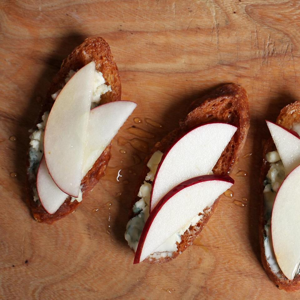 """These little toasts are crisp and savory-sweet, thanks to the combo of creamy gorgonzola, sage leaves, crisp apples, and <a href=""""https://www.epicurious.com/ingredients/pastry-chefs-on-the-best-honeys-to-buy-article?mbid=synd_yahoo_rss"""" rel=""""nofollow noopener"""" target=""""_blank"""" data-ylk=""""slk:honey"""" class=""""link rapid-noclick-resp"""">honey</a>. <a href=""""https://www.epicurious.com/recipes/food/views/blue-cheese-apple-and-sage-honey-crostini-51255310?mbid=synd_yahoo_rss"""" rel=""""nofollow noopener"""" target=""""_blank"""" data-ylk=""""slk:See recipe."""" class=""""link rapid-noclick-resp"""">See recipe.</a>"""