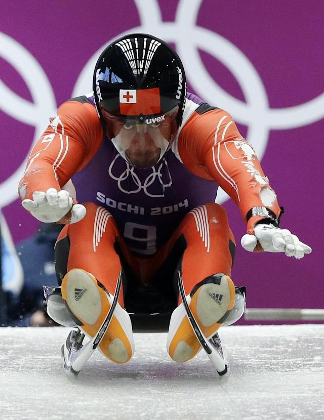 Bruno Banani of Tonga starts a run during a training session for the men's singles luge at the 2014 Winter Olympics, Thursday, Feb. 6, 2014, in Krasnaya Polyana, Russia. (AP Photo/Dita Alangkara)