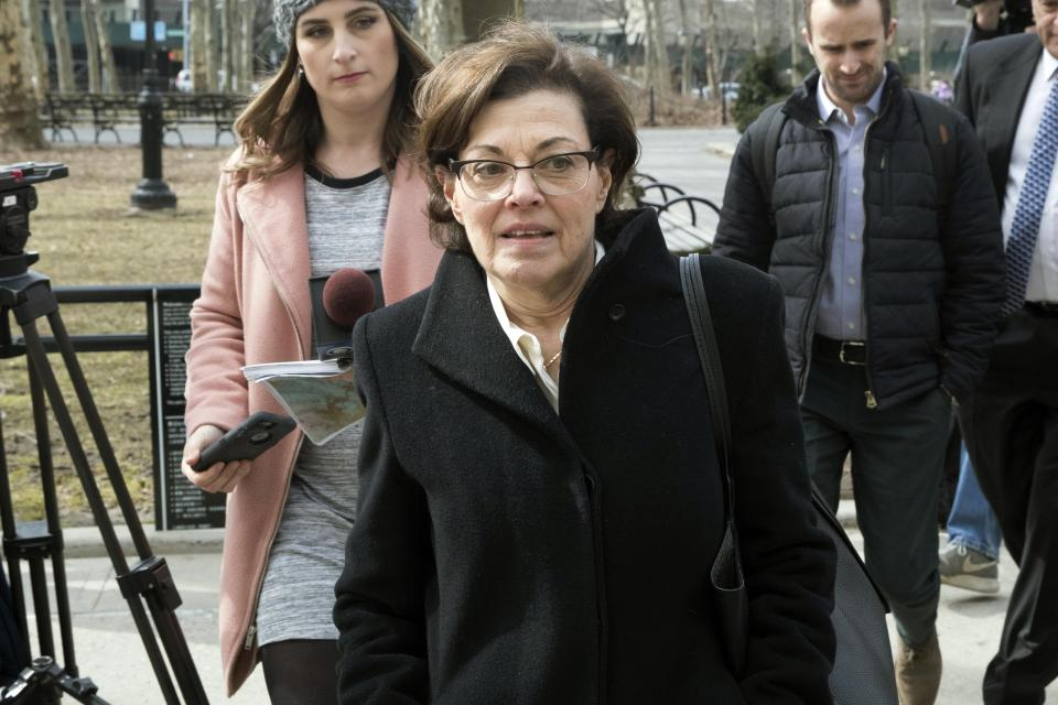 FILE — In this March 13, 2019 file photo, Nancy Salzman, center, arrives at Brooklyn federal court, in New York. Salzman, the former president and co-founder of NXIVM, was sentenced Wednesday, Sept. 8, 2021, to 42 months in prison and fined $150,000, but won't be locked up until January. (AP Photo/Mary Altaffer, File)