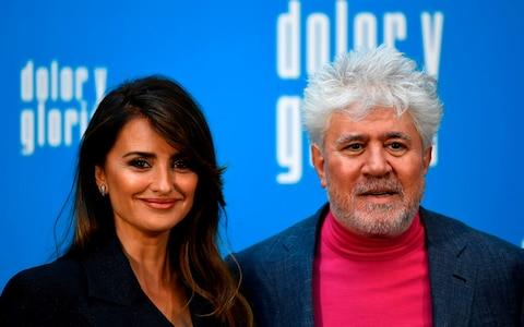 Director Pedro Almodovar and Penelope Cruz during the photocall for Pain and Glory - Credit: GABRIEL BOUYS/AFP