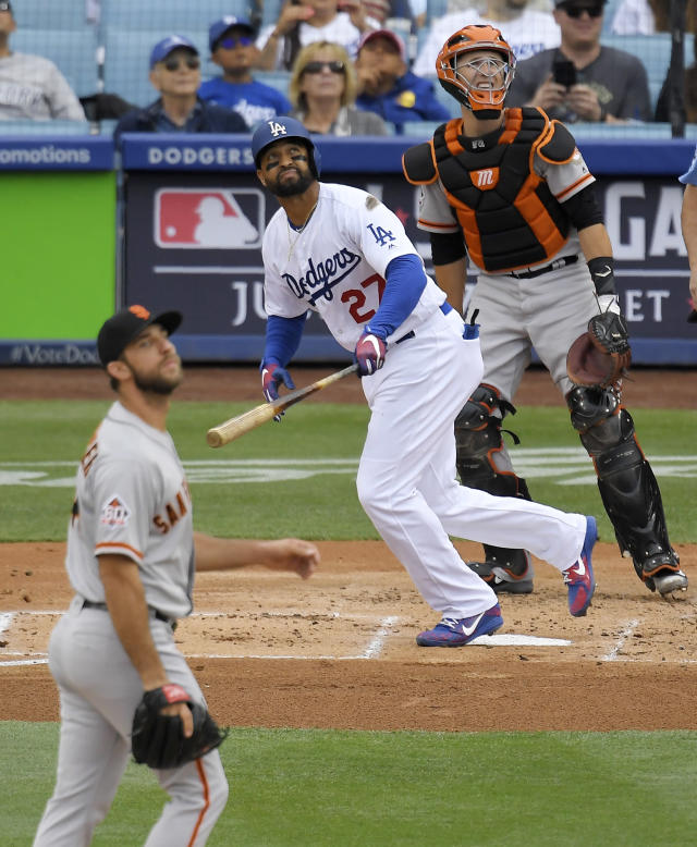 Los Angeles Dodgers' Matt Kemp, center, hits a solo home run as San Francisco Giants starting pitcher Madison Bumgarner, left, watches along with catcher Buster Posey during the second inning of a baseball game Saturday, June 16, 2018, in Los Angeles. (AP Photo/Mark J. Terrill)