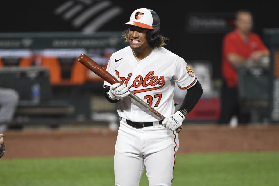 Baltimore Orioles' Jahmai Jones (37) reacts to strike out against Los Angeles Angels relief pitcher Junior Guerra during the fourth inning of a baseball game Tuesday, Aug. 24, 2021, in Baltimore. (AP Photo/Terrance Williams)