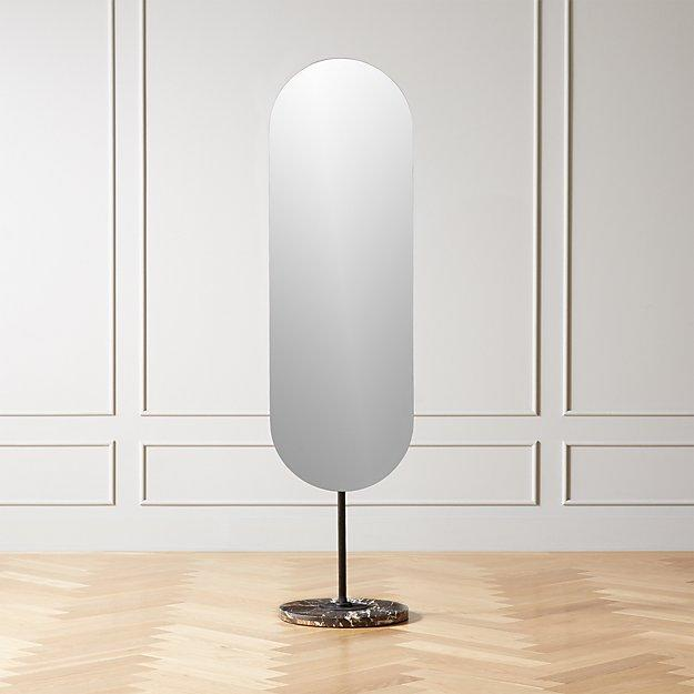 """While this freestanding frameless mirror doesn't technically hit the floor, you'll still be able to check out your whole 'fit in it. The black marble base adds a gorgeous texture to an otherwise naked mirror, and as you can already tell, we're suckers for an oval shape. $449, CB2. <a href=""""https://www.cb2.com/legato-marble-oval-floor-mirror/s477030"""" rel=""""nofollow noopener"""" target=""""_blank"""" data-ylk=""""slk:Get it now!"""" class=""""link rapid-noclick-resp"""">Get it now!</a>"""