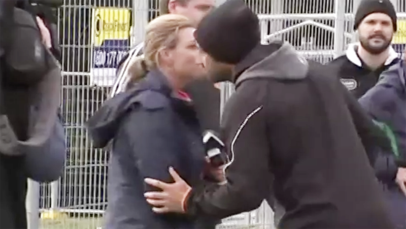 Wests Tigers star Benji Marshall is pictured giving Channel 7 reporter Michelle Bishop a kiss on the cheek.