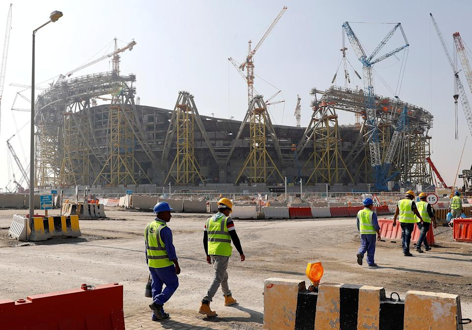 Workers walk towards the construction site of the Lusail Stadium, which will host the World Cup final in 2022 (REUTERS)