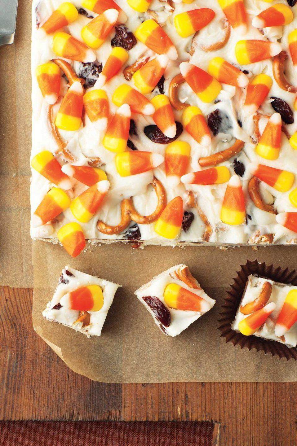 """<p>The secret ingredient: tart cherries that make sure sweet candy corn isn't too overpowering in this bite-size treat. </p><p><em><strong><a href=""""https://www.womansday.com/food-recipes/food-drinks/recipes/a11819/candy-corn-fudge-recipe-123647/"""" rel=""""nofollow noopener"""" target=""""_blank"""" data-ylk=""""slk:Get the Candy Corn Fudge recipe."""" class=""""link rapid-noclick-resp"""">Get the Candy Corn Fudge recipe.</a></strong></em></p>"""