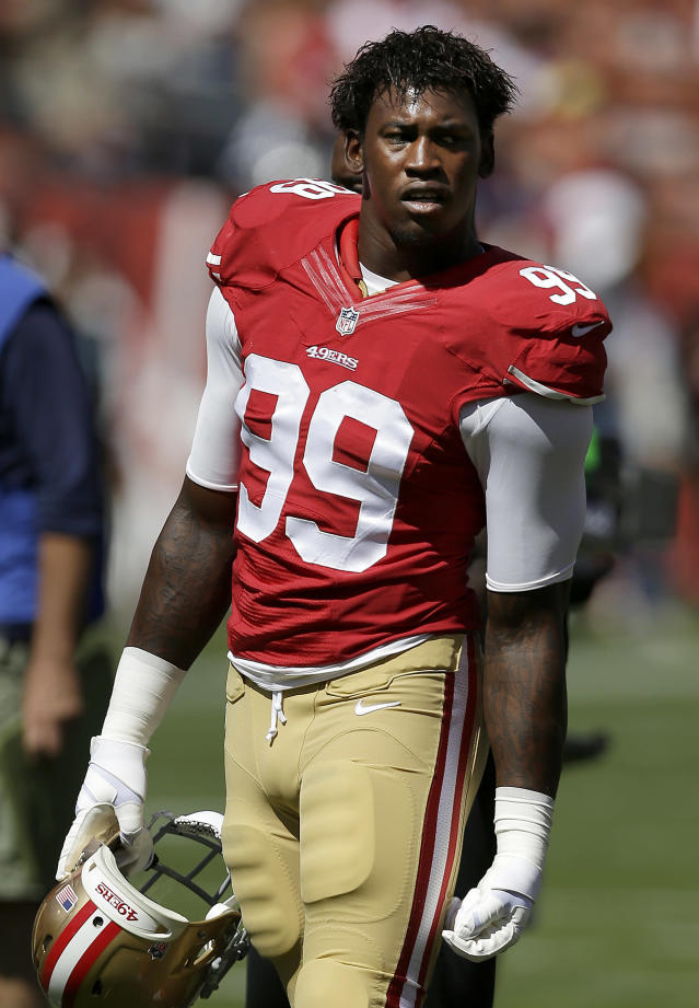 San Francisco 49ers linebacker Aldon Smith (99) stands on the field before an NFL football game against the Indianapolis Colts in San Francisco, Sunday, Sept. 22, 2013. Smith is active and set to play against the Colts two days after being arrested and jailed on suspicion of driving under the influence and marijuana possession. (AP Photo/Marcio Jose Sanchez)