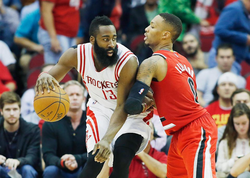 HOUSTON, TX - DECEMBER 22: James Harden #13 of the Houston Rockets looks to drive with the ball against Damian Lillard #0 of the Portland Trail Blazers during their game at the Toyota Center on December 22, 2014 in Houston, Texas. (Photo by Scott Halleran/Getty Images)