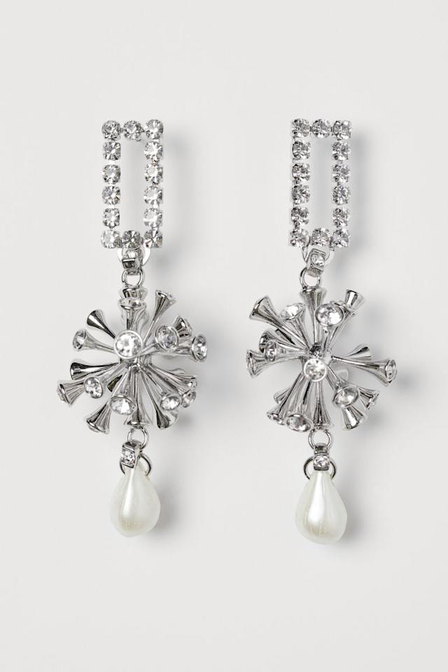 """<p>We'd wear these <a href=""""https://www.popsugar.com/buy/HampM-Large-Rhinestone-Earrings-498395?p_name=H%26amp%3BM%20Large%20Rhinestone%20Earrings&retailer=www2.hm.com&pid=498395&price=50&evar1=fab%3Aus&evar9=46720530&evar98=https%3A%2F%2Fwww.popsugar.com%2Ffashion%2Fphoto-gallery%2F46720530%2Fimage%2F46720531%2FHM-Large-Rhinestone-Earrings&list1=shopping%2Ch%26m%2Ceco%2Csustainable%20fashion&prop13=mobile&pdata=1"""" rel=""""nofollow"""" data-shoppable-link=""""1"""" target=""""_blank"""" class=""""ga-track"""" data-ga-category=""""Related"""" data-ga-label=""""https://www2.hm.com/en_us/productpage.0818017001.html"""" data-ga-action=""""In-Line Links"""">H&amp;M Large Rhinestone Earrings</a> ($50) pretty much anywhere.</p>"""