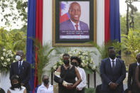 First Lady Martine Moise, center, attends a tribute for her late husband President Jovenel Moise at the National Pantheon Museum in Port-au-Prince Haiti, Wednesday, July 21, 2021. President Moise was assassinated on July 7 during an attack at their home that left her injured. (AP Photo/Joseph Odelyn)