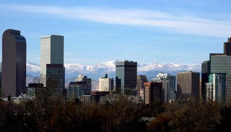 FILE PHOTO: The Continental Divide is seen in the background behind the downtown city skyline in Denver