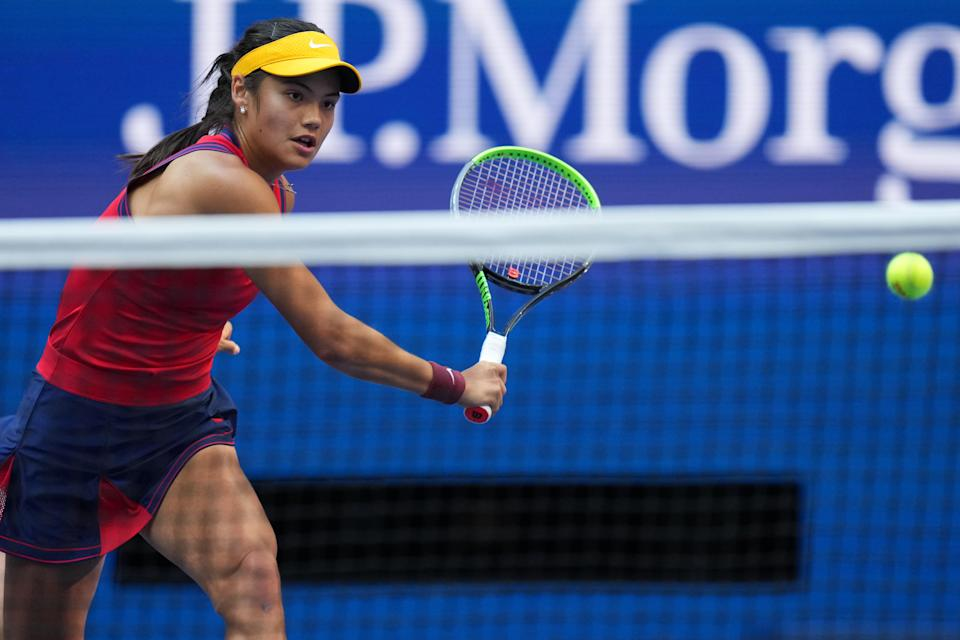 Sep 11, 2021; Flushing, NY, USA; Emma Raducanu of Great Britain hits a volley against Leylah Fernandez of Canada (not pictured) in the women's singles final on day thirteen of the 2021 U.S. Open tennis tournament at USTA Billie Jean King National Tennis Center. Mandatory Credit: Danielle Parhizkaran-USA TODAY Sports