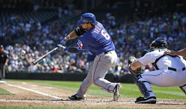 Texas Rangers' Tomas Telis (6) doubles in three runs as Seattle Mariners catcher Mike Zunino looks on in the second inning of a baseball game Wednesday, Aug. 27, 2014, in Seattle. AP Photo/Elaine Thompson)