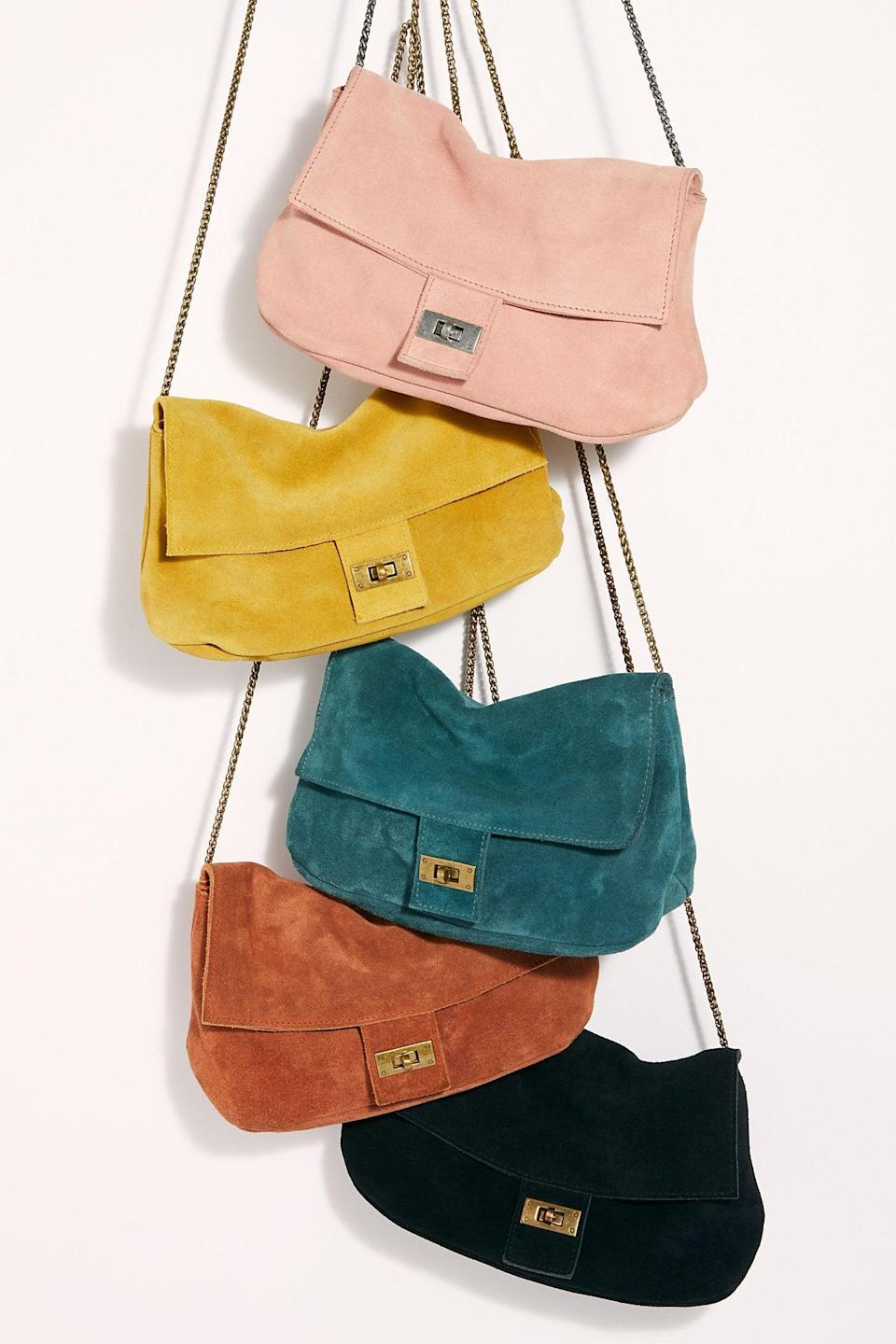 """<p>We want this <a href=""""https://www.popsugar.com/buy/Slouchy-Suede-Shoulder-Bag-527151?p_name=Slouchy%20Suede%20Shoulder%20Bag&retailer=freepeople.com&pid=527151&price=58&evar1=fab%3Aus&evar9=45460327&evar98=https%3A%2F%2Fwww.popsugar.com%2Ffashion%2Fphoto-gallery%2F45460327%2Fimage%2F46978001%2FSlouchy-Suede-Shoulder-Bag&list1=shopping%2Cgifts%2Cfree%20people%2Choliday%2Cgift%20guide%2Cgifts%20for%20women&prop13=api&pdata=1"""" class=""""link rapid-noclick-resp"""" rel=""""nofollow noopener"""" target=""""_blank"""" data-ylk=""""slk:Slouchy Suede Shoulder Bag"""">Slouchy Suede Shoulder Bag</a> ($58) in every shade.</p>"""