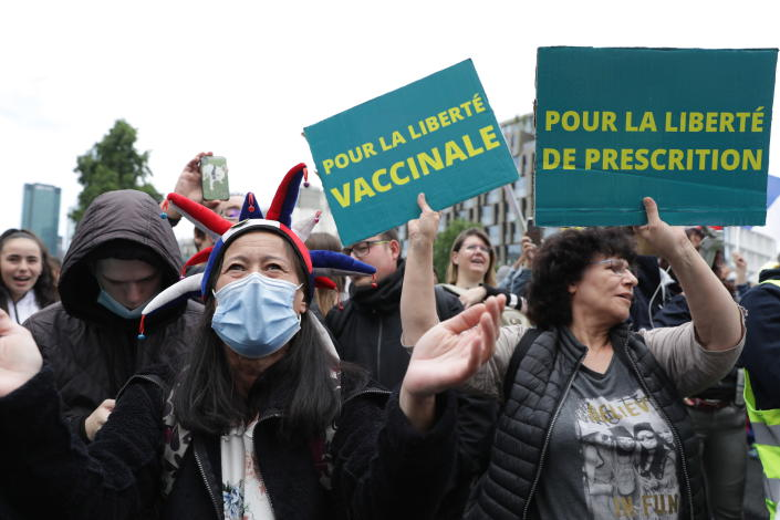 Anti-vax protesters against the vaccine and vaccine passports, during a demonstration in Paris, France, Saturday Aug. 7, 2021. Some thousands of people are expected to march in Paris and other French cities on Saturday to protest against a special virus pass and what they see as restrictions of personal freedoms. (AP Photo / Adrienne Surprenant)