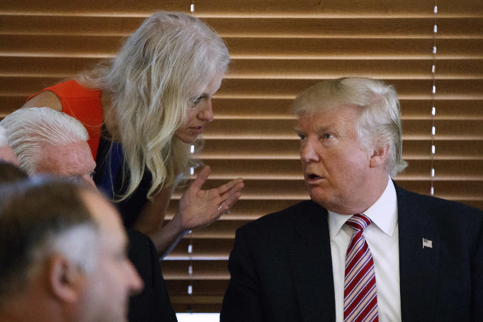 Republican presidential candidate Donald Trump talks with his campaign manager, Kellyanne Conway, during a visit to Goody's Restaurant in Brook Park, Ohio. (Photo: Evan Vucci/AP)