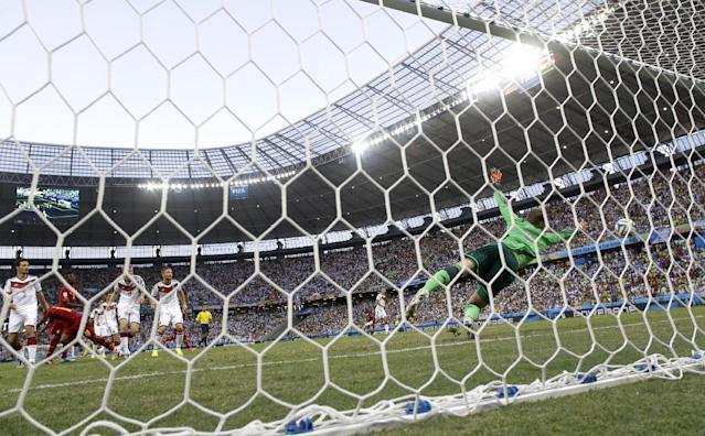 Ghana's Andre Ayew, second left, scores his side's first goal past Germany's goalkeeper Manuel Neuer during the group G World Cup soccer match between Germany and Ghana at the Arena Castelao in Fortaleza, Brazil, Saturday, June 21, 2014. (AP Photo/Marcio Jose Sanchez)