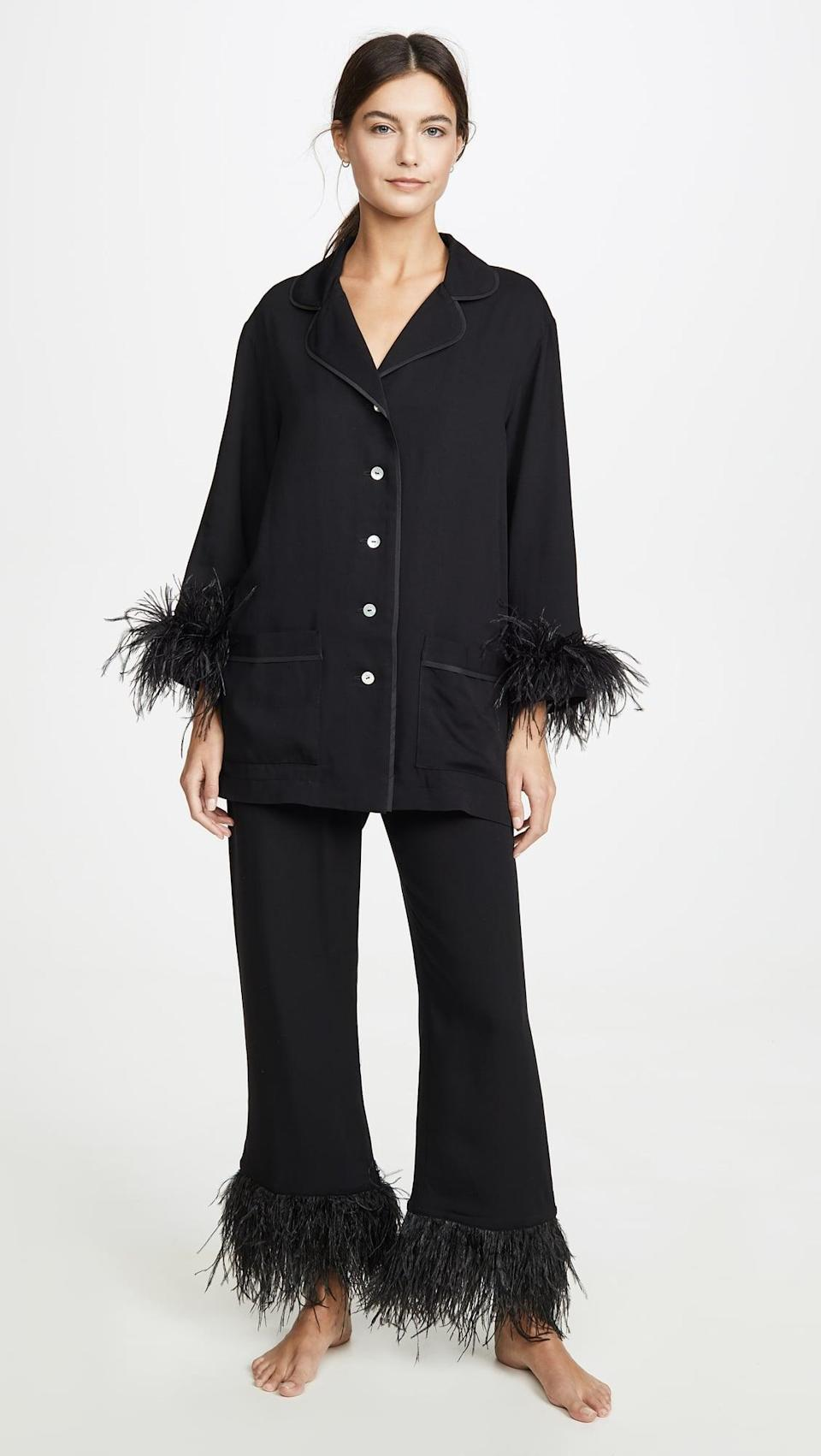 <p>We all know someone who needs this <span>Sleeper Black Tie PJ Set With Feathers</span> ($320).</p>