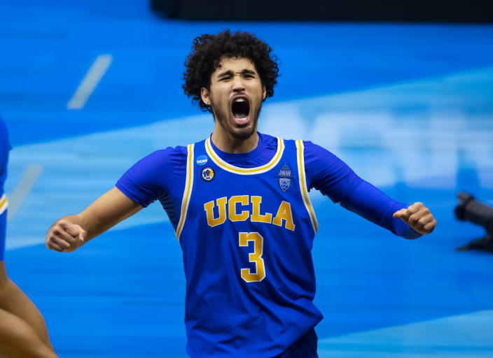 Mar 30, 2021; Indianapolis, IN, USA; UCLA Bruins guard Johnny Juzang (3) celebrates after advancing to the Final Four following their win in the Elite Eight of the 2021 NCAA Tournament against the Michigan Wolverines at Lucas Oil Stadium.