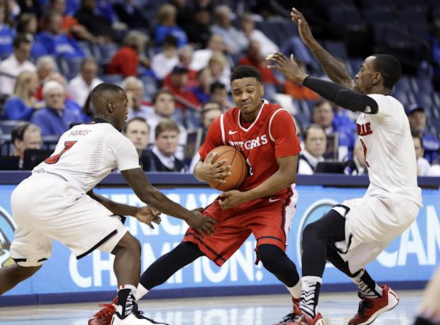 Rutgers guard Myles Mack, center, is caught between Louisville defenders Chris Jones, left, and Russ Smith, right, during the first half of an NCAA college basketball game in the quarterfinals of the American Athletic Conference tournament on Thursday, March 13, 2014, in Memphis, Tenn. (AP Photo/Mark Humphrey)