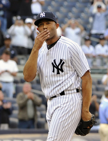 FILE - In this Sept. 19, 2011 file photo, New York Yankees' Mariano Rivera blows a kiss to the crowd to acknowledge cheers after recording his 602nd save as the Yankees beat the Minnesota Twins 6-4 in a baseball game at Yankee Stadium in New York. A person familiar with the decision says that Rivera plans to retire after the 2013 season. The person spoke to The Associated Press on Thursday, March 7, 2013, on condition of anonymity because there had been no official announcement. (AP Photo/Kathy Kmonicek, File)